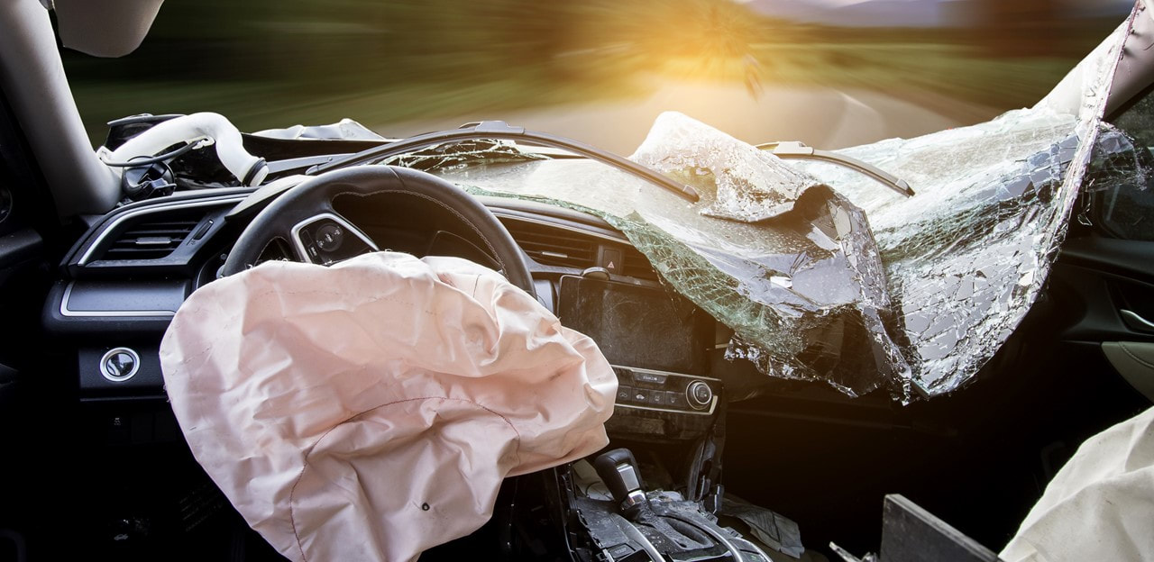 image of a car with windshield crushed into vehicle and airbags deployed - Catastrophic Injury Attorneys - Lundy Lundy Soileau & South